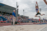 Blue Springs senior Jacob Priester flies toward the sand pit on his way to victory in the boys triple jump with a personal record jump of 48-5.5 at the 2015 Kansas Relays.