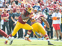 Washington Redskins running back Matt Jones (31) runs for a touchdown in the second quarter against the Dallas Cowboys at FedEx Field in Landover, Maryland on Sunday, September 18, 2016.  Washington Redskins guard Shawn Lauvao (77) provides a block.<br /> Credit: Ron Sachs / CNP /MediaPunch