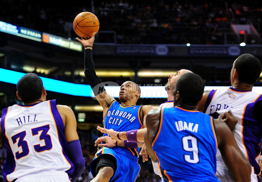Mar. 30, 2011; Phoenix, AZ, USA; Oklahoma City Thunder guard (0) Russell Westbrook drives to the basket in the fourth quarter against the Phoenix Suns at the US Airways Center. The Thunder defeated the Suns 116-98. Mandatory Credit: Mark J. Rebilas-