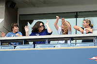 FLUSHING NY- SEPTEMBER 2: Rosie O'Donnell does the wave with her guest during Novak Jokovic Vs Julien Benneteau on Arthur Ashe stadium at the USTA Billie Jean King National Tennis Center on September 2, 2012 in in Flushing Queens. Credit: mpi04/MediaPunch Inc. ***NO NY NEWSPAPERS*** /NortePhoto.com<br />