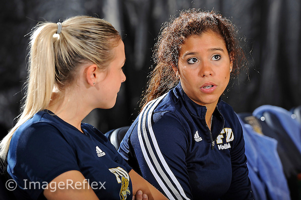 11 September 2011:  FIU Student Assistant Coach Natalia Valentin (right) speaks with Assistant Coach Ines Medved (left) prior to the match.  The FIU Golden Panthers defeated the Florida A&M University Rattlers, 3-0 (25-10, 25-23, 26-24), at U.S Century Bank Arena in Miami, Florida.