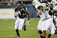 14 November 2009:  FIU running back Daunte Owens (8) carries the ball in the first half as the FIU Golden Panthers defeated the North Texas Mean Green, 35-28, at FIU Stadium in Miami, Florida.