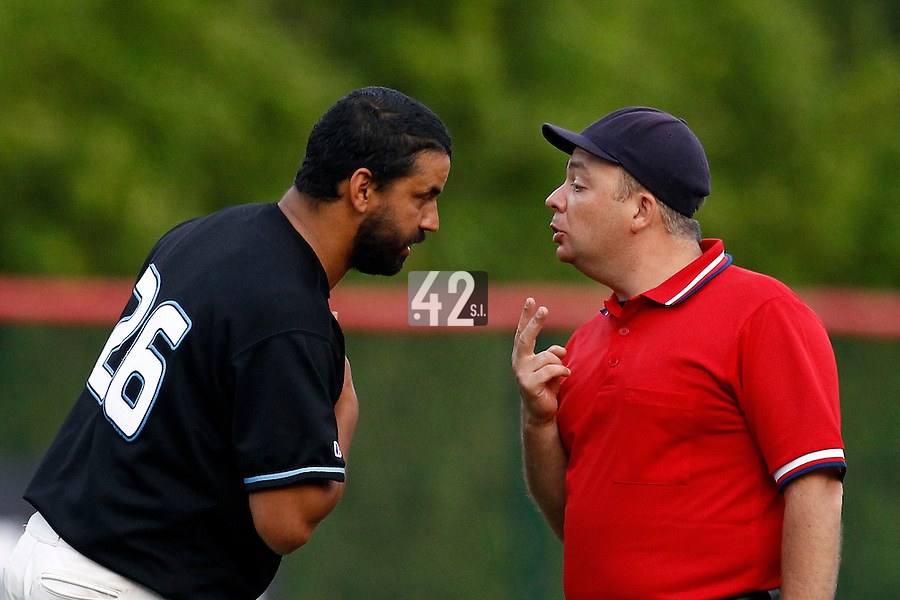 15 July 2011: Starting pitcher Jamel Boutagra of the Senart Templiers argues with umpire Fabien Carette Legrand during the 2011 Challenge de France match won 6-5 by the Rouen Huskies over the Senart Templiers at Stade Pierre Rolland, in Rouen, France.