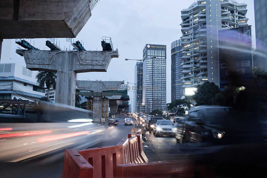 JAKARTA, INDONESIA, MAY 2013:<br /> View of Sudirman Street the center of Jakarta, May 2013. the traffic in Jakarta is so bad that the government is trying to buil many flyover all over the city, to avoid congestion during the rush hours<br /> © Giulio Di Sturco for Bloomberg Markets