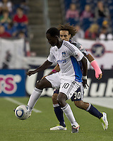 San Jose Earthquakes midfielder Simon Dawkins (10) traps the ball as New England Revolution defender Kevin Alston (30) pressures. In a Major League Soccer (MLS) match, the San Jose Earthquakes defeated the New England Revolution, 2-1, at Gillette Stadium on October 8, 2011.