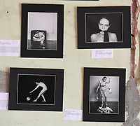 NWA Democrat-Gazette/J.T. WAMPLER A collection of photographs by Marcha Lane Foster is on display Saturday Nov. 11, 2017 at a pop-up art show in downtown Springdale. The show was to raise money for Returning Home, an umbrella charity that helps people convicted of felonies return to society and stay out of jail. All art was related to issues surrounding Òwomen in jailÓ in some way.