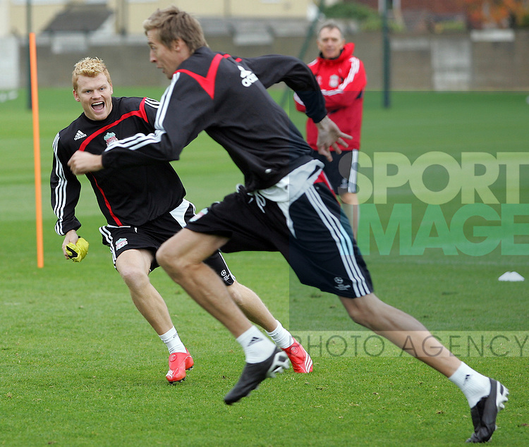 Liverpool Champions League Training, Melwood Training Complex, West Derby, Liverpool, 5th November 2007...John Arne Riise (L) chases team-mate Peter Crouch.