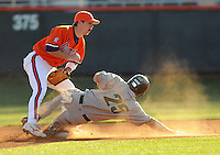 Mike Freeman (5) puts the tag on Alan Parks (25) during a game between the Charlotte 49ers and Clemson Tigers Feb. 20, 2009, at Doug Kingsmore Stadium in Clemson, S.C. (Photo by: Tom Priddy/Four Seam Images) 25 and 5
