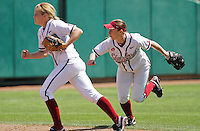 STANFORD, CA - April 3, 2011:  Sarah Hassman throws out a runner at home while Ashley Hansen looks on during Stanford's 2-0 loss to Arizona at Stanford, California on April 3, 2011.