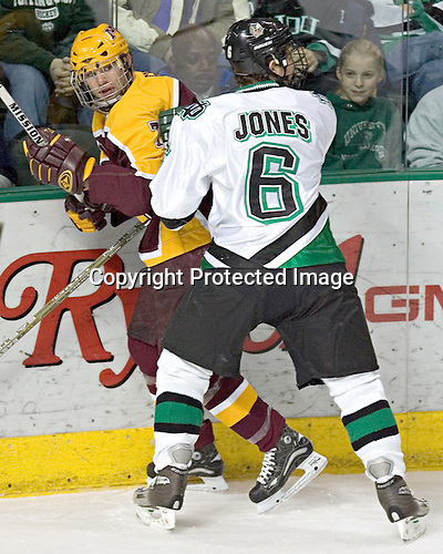 Gino Guyer, Zach Jones - The University of Minnesota Golden Gophers defeated the University of North Dakota Fighting Sioux 4-3 on Saturday, December 10, 2005 completing a weekend sweep of the Fighting Sioux at the Ralph Engelstad Arena in Grand Forks, North Dakota.
