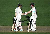 Kane Williamson is congratulated bt Tom Latham on reaching 50.<br /> New Zealand Blackcaps v England. 1st day/night test match. Eden Park, Auckland, New Zealand. Day 1, Thursday 22 March 2018. &copy; Copyright Photo: Andrew Cornaga / www.Photosport.nz