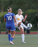 Western New York Flash midfielder McCall Zerboni (7) clears the ball.  In a National Women's Soccer League Elite (NWSL) match, the Boston Breakers (blue) tied Western New York Flash (white), 2-2, at Dilboy Stadium on June 5, 2013.