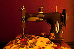 Antique sewing machine with fabric and thread spools