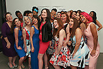 Fashion designer Mallorie Carrington poses with models (center, red-dress, black jacket) her Smart Glamour Spring 2015 collection fashion show, sponsored by Sydney Stone and Stylaphile at the Thierry-Goldberg Gallery on February 20, 2015.