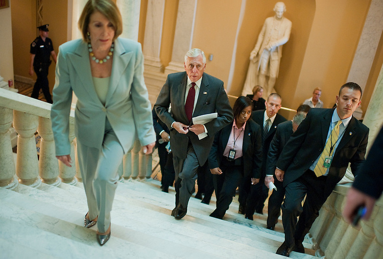 UNITED STATES - SEPTEMBER 23:  House Minority Whip Steny Hoyer, D-Md., center, and House Minority Leader Nancy Pelosi, D-Calif., make their way to a news conference in the Capitol on a potential vote Monday on a measure to fund the government and the Federal Emergency Management Agency.  (Photo By Tom Williams/Roll Call)