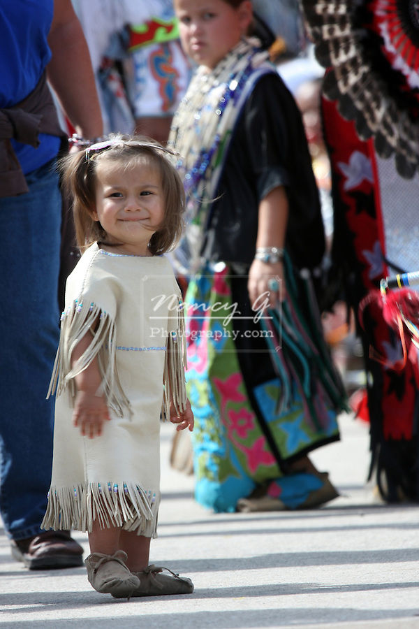 A young female Native American child in a traditional leather dress at a Pow Wow at the Milwaukee Lakefront Indian Summer Festival, Wisconsin