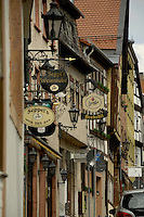 Hanging signs from restaurant and bar exteriors. Old town, Aschaffenburg, Germany.