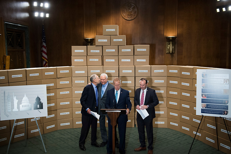 UNITED STATES - AUGUST 02: From left, Senate Judiciary Committee Chairman Charles Grassley, R-Iowa, Sens. Orrin Hatch, R-Utah, Thom Tillis, R-N.C., and Mike Lee, R-Utah, conduct a news conference in Dirksen Building on August 2, 2018, with boxes representing the roughly 1 million pages of documents to be submitted to the committee on Supreme Court nominee Brett Kavanaugh. (Photo By Tom Williams/CQ Roll Call)