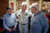 NWA Democrat-Gazette/DAVID GOTTSCHALK   Vernon Hammock (from left), Jim Oden and Phillip Ball, all Korean War veterans, visit Monday, May 1, 2017, before receiving a copy of the book titled Korea Reborn A Grateful Nation in Fayetteville. The three were part of a group of nine Korean War veterans that were recognized by the Northwest Arkansas Chapter of Military Officers Association of America Monday and received the book. The books were published by the South Korean government in gratitude of the United States military service in the war and documents the growth and progress that country has sustained over the past 60 years.