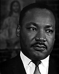 Closeup of Dr. Martin Luther King Jr waiting to speak at Alabama Church.   This and over 10,000 other images are part of the Jim Peppler Collection at The Alabama Department of Archives and History:  http://digital.archives.alabama.gov/cdm4/peppler.php