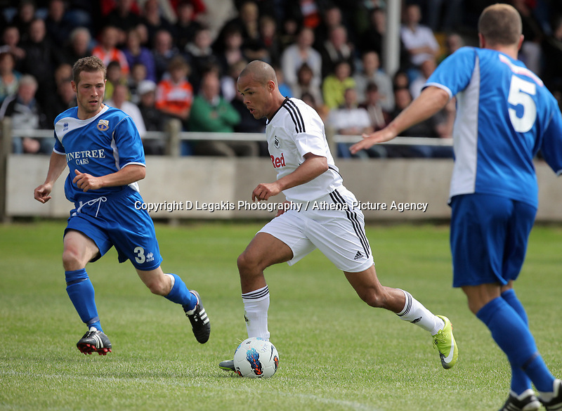 Pictured: Casey Thomas of Swansea (C) against Kye Edwards (R) and Paul Keddle (L) of Port Talbot. Saturday 17 July 2011<br /> Re: Pre season friendly, Port Talbot Football Club v Swansea City FC at the GenQuip ground, Port Talbot, south Wales.