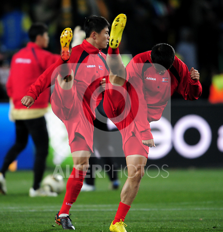 North Korean players warm up  before the 2010 FIFA World Cup South Africa Group G match between Brazil and North Korea at Ellis Park Stadium on June 15, 2010 in Johannesburg, South Africa.