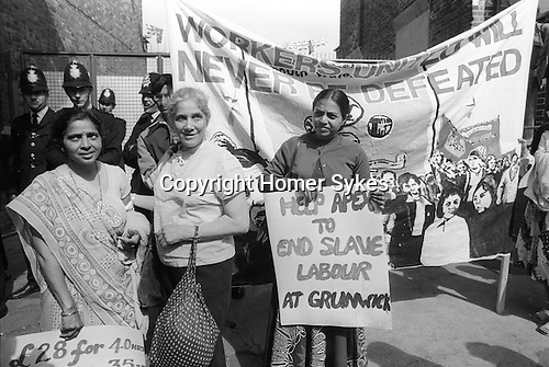 "Grunwick Strike North London UK.  South asian women strikers Mrs Jayaben Desai on left with banner that reads £28-00 for a 40 hour weeks, seen here with supporters and Yasu Patel with the banner, ""Help Apex To End Slave Labour at Grunwick""."