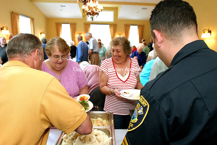 MIDDLEBURY, CT --JUNE 23, 2008-062308JS01-Middlebury police officers Pat Deely, left and Ron Pruchnicki, right, serve food to Sandy Goldberg and Angela Voytek, both of Middlebury, during brunch Mondy at Juniper's Restaurant in Middlebury. The third annual event, organized by the Middlebury Police Department and the Police Benevolent Association, is to thank seniors from the Middlebury Senior Center for their support throughout the year. <br /> Jim Shannon/Republican-American