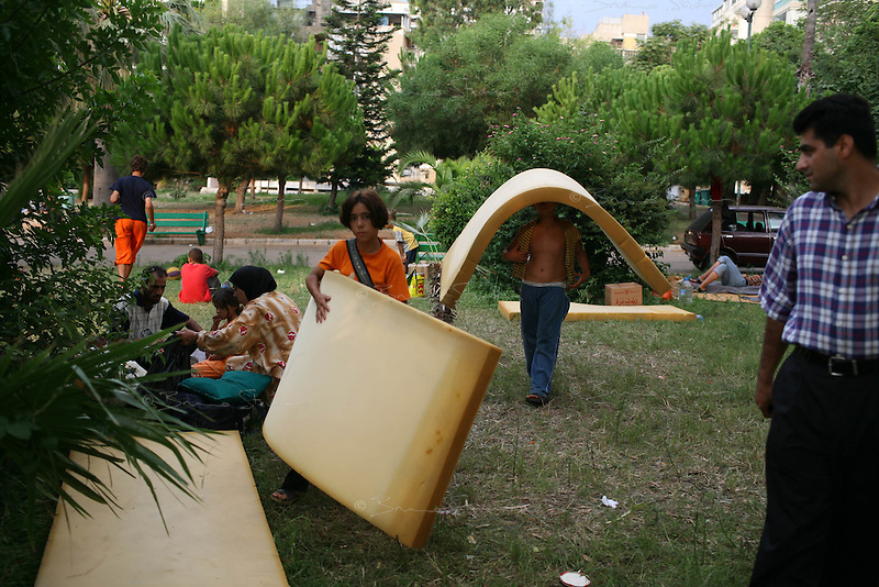 Beirut, Lebanon, July 16 2006.Jouneyeh public parc, refugee families shortly before being transfered to a nearby school for shelter by local officials.