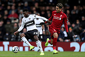 17th March 2019, Craven Cottage, London, England; EPL Premier League football, Fulham versus Liverpool; Andre-Frank Zambo Anguissa of Fulham takes on Roberto Firmino of Liverpool