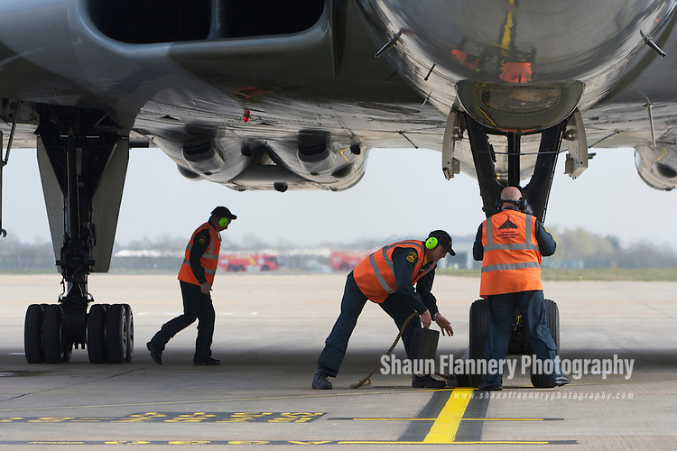 Pix: Shaun Flannery/shaunflanneryphotography.com...COPYRIGHT PICTURE>>SHAUN FLANNERY>01302-570814>>07778315553>>..29th March 2011..............The last flying Vulcan, XH558,  touches down at Robin Hood Airport Doncaster Sheffield. .Vulcan XH558 is to spend the summer based at the airfield where she once stood on Quick Reaction Alert during the Cold War..Operatives from the Vulcan Operating Company Engineering.
