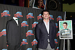 "Nick Jonas donates his Suit & Tie from 'How To Succeed in Business"" with the help of costars Michael Urie & Stephanie Rothenberg at Planet Hollywood in New York City on 4/9/2012"