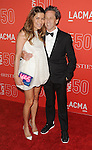 Brian Grazer and date arriving at LACMA's 50th Anniversary Gala Los Angeles CA. April 18, 2015