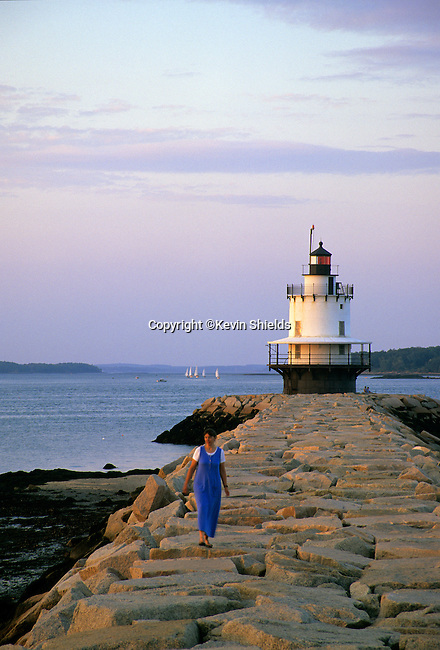 Woman on the breakwater at Spring Point Light, South Portland, Maine, USA