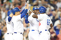 06/06/13 Los Angeles, CA: Los Angeles Dodgers  Yasiel Puig #66, Luis Cruz #47, Skip Schumaker #3 and Hanley Ramirez #13 celebrate after Puig hit a grand slam in the 8th inning during an MLB game played between the Los Angeles Dodgers and the Atlanta Braves at Dodger Stadium. The Dodgers defeated the Braves 5-0.