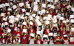 Wisconsin Badgers hold up white sheets of paper after freshman running back James White (20) carries the ball during an NCAA college football game against the Ohio State Buckeyes on October 16, 2010 at Camp Randall Stadium in Madison, Wisconsin. The Badgers beat the Buckeyes 31-18. (Photo by David Stluka)