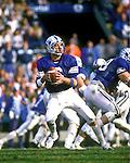 Bosco-84<br /> <br /> Quarterback 6 Robbie Bosco goes back to pass<br /> <br /> 1984<br /> <br /> Photo by Mark Philbrick/BYU<br /> <br /> &copy; BYU PHOTO 2009<br /> All Rights Reserved<br /> photo@byu.edu  (801)422-7322