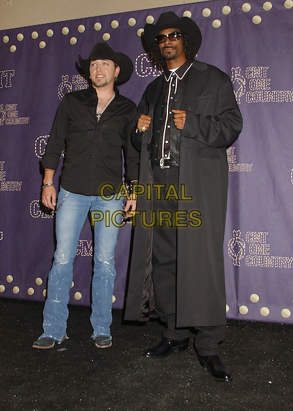 JASON ALDEAN & SNOOP DOGG.2008 CMT Music Awards held at Curb Center, Nashville, Tennessee, USA..April 14th, 2008.full length black jeans denim black coat jacket trench  stetson cowboy hat facial hair .CAP/ADM/LF.©Laura Farr/AdMedia/Capital Pictures.