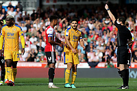 Referee Mr Darren England shows a red card to Wigan's Sam Morsy during Brentford vs Wigan Athletic, Sky Bet EFL Championship Football at Griffin Park on 15th September 2018