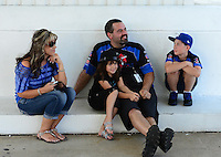 Sept. 23, 2012; Ennis, TX, USA: NHRA pro stock driver Chris McGaha with his family during the Fall Nationals at the Texas Motorplex. Mandatory Credit: Mark J. Rebilas-