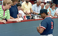 Boston Red Sox catcher Tony Pena (6) signs autographs during spring training circa 1992 at Chain of Lakes Park in Winter Haven, Florida.  (MJA/Four Seam Images)