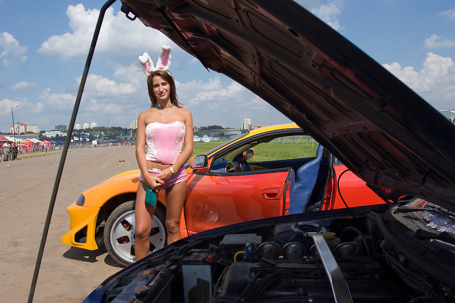 Moscow, Russia 13/07/2008..A woman in a bunny outfit  at the annual Autoexotica Show, a ten day festival that attracts thousands of Russian motor enthusiasts.  Figures show the Russian auto market has just overtaken Germany's to become the largest in Europe, and analysts predict that within four years it will be the third largest in the world.