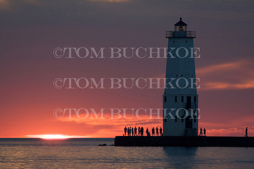 Sunset on Lake Michigan, behind the Frankfort North Breakwater lighthouse, Frankfort Michigan.