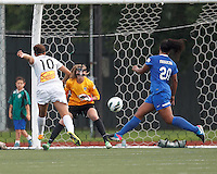 Western New York Flash midfielder Carli Lloyd (10) scoring effort. In a National Women's Soccer League (NWSL) match, Boston Breakers (blue) tied Western New York Flash (white), 2-2, at Dilboy Stadium on August 3, 2013.