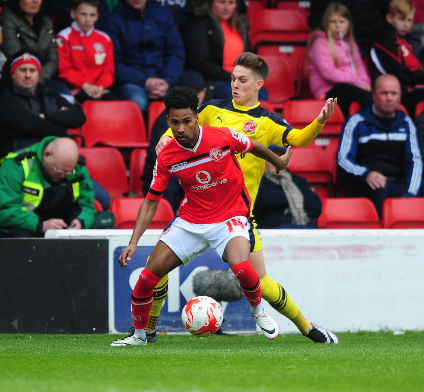 Walsall's Rico Henry shields the ball from Fleetwood Town's Nick Haughton<br /> <br /> Photographer Chris Vaughan/CameraSport<br /> <br /> Football - The Football League Sky Bet League One - Walsall v Fleetwood Town - Monday 2nd May 2016 - Banks's Stadium - Walsall   <br /> <br /> &copy; CameraSport - 43 Linden Ave. Countesthorpe. Leicester. England. LE8 5PG - Tel: +44 (0) 116 277 4147 - admin@camerasport.com - www.camerasport.com