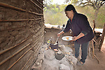Justina Romero cooks food at her home in the Guarani indigenous village of Kapiguasuti, Bolivia. She and her neighbors started kitchen gardens with assistance from Church World Service, supplementing their corn-based diet with nutritious vegetables and fruits.