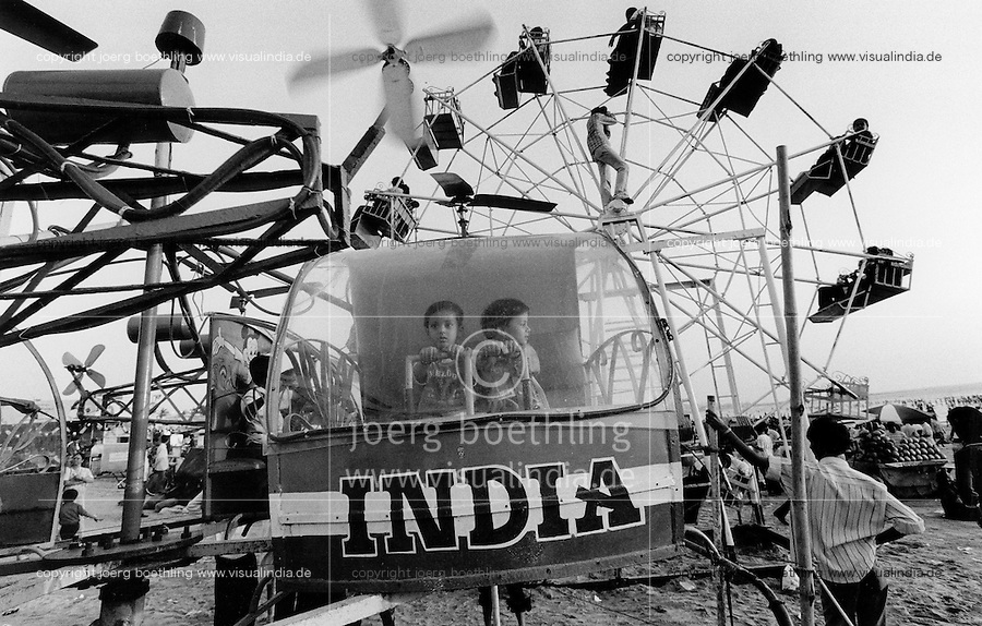 INDIA Mumbai Bombay, Juhu beach, Santa Cruz, sunday entertainment for Mumbais citizen, children in man-powered carousel - copyright (c) Joerg Boethling, Also as signed black and white Baryt Fine print available!