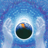Hands protecting glowing planet earth