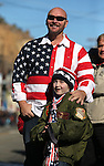 Bryan McGill and his daughter Summer, 8, watch the annual Veterans Day parade in Virginia City, Nev., on Wednesday, Nov. 11, 2015. <br /> Photo by Cathleen Allison