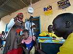 A child is weighed in a clinic located inside a camp for more than 12,000 internally displaced persons located on the grounds of the Roman Catholic Cathedral of St. Mary in Wau, South Sudan. Most of the families here were displaced in June, 2016, when armed conflict engulfed Wau.<br /> <br /> Norwegian Church Aid, a member of the ACT Alliance, has provided relief supplies to the displaced in Wau, and has supported the South Sudan Council of Churches as it has struggled to mediate the conflict in Wau.